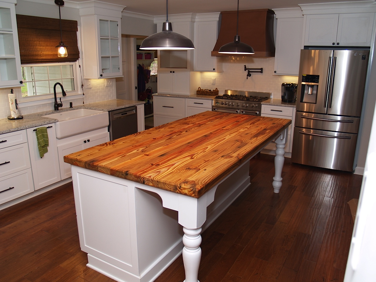 Reclaimed wood countertop heart pine 3 8 bead edge with butchers wax food grade finish installed in waxhaw north carolina