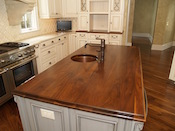 "Walnut kitchen countertop, wide plank flat grain construction, 1.75"" thick, large double roman ogee edge, undermount sink, with permanent finish. This custom walnut wood island countertop was installed in Weddington, NC."