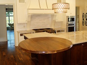 "Walnut wood countertop, 54"" diameter, large double roman ogee edge, permanent finish. This walnut round top was installed in Charlotte, NC ."
