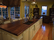 "Custom Walnut wood island countertop with 2 undermount farm sinks. This wide plank walnut countertop has a large cove and bead edge profile. Dimension are 1.75"" thick x 50"" x 188"". Expanded corners on both ends of top. Permanent finish. Installed just outside of Charlotte in Weddington , NC."
